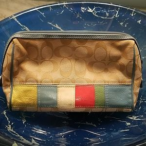 Coach tan cosmetic bag